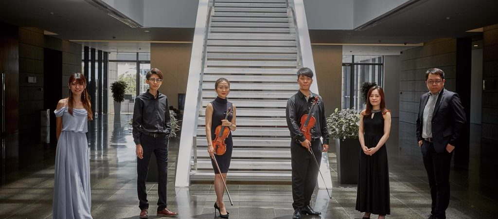 Six of the finest young classical musicians in the city stand in the Macao Cultural Centre lobby