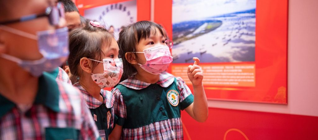 Children visit the photo exhibition celebrating the 100th anniversary of the founding of the Communist Party of China - Photo by Cheong Kam Ka
