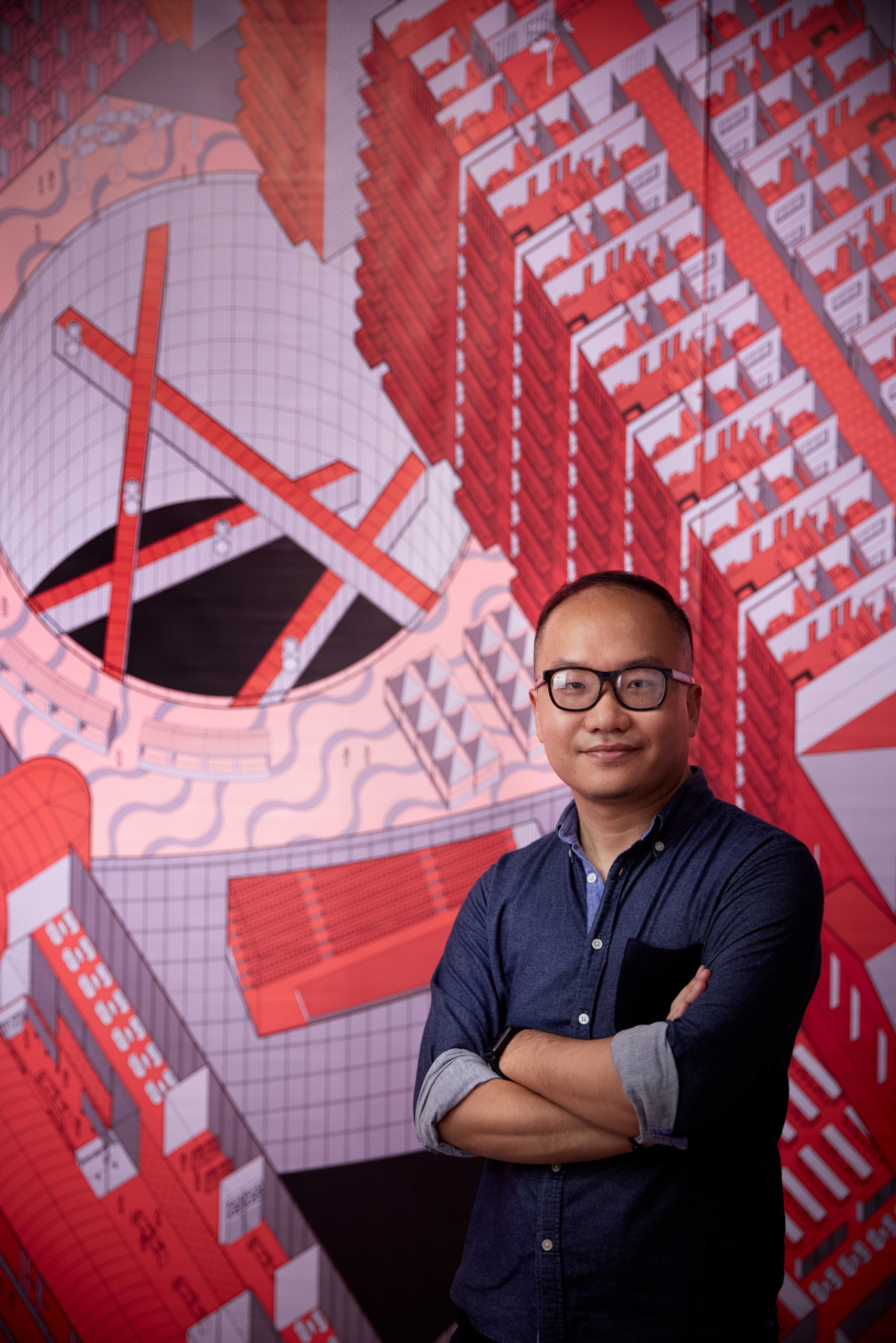 Daniel Ho Ting Fong in front of his floor-to-ceiling digital drawing in his 'Boundary Verticalisation – the Collision of Two Different Urban System' exhibition